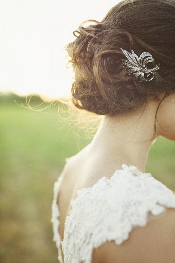 We love the softness up this upswept style — and the fact that this bride chose to accessorize her hair with a vintage-looking brooch is simply stunning. This look is especially beautiful for 2013 as it is the perfect choice to showcase a dramatic dress back, which is one of the biggest bridal fashion trends of the year.