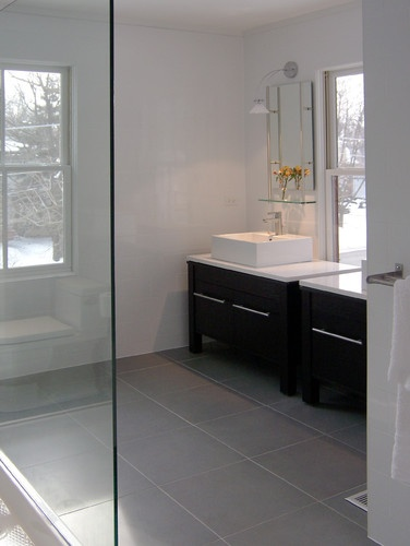 Exactly the colour palette I'm thinking about ... dark wood vanity (wall-hung, though), rectangle vessel sinks, grey floor tile, etc.)  corner bathroom modern bathroom