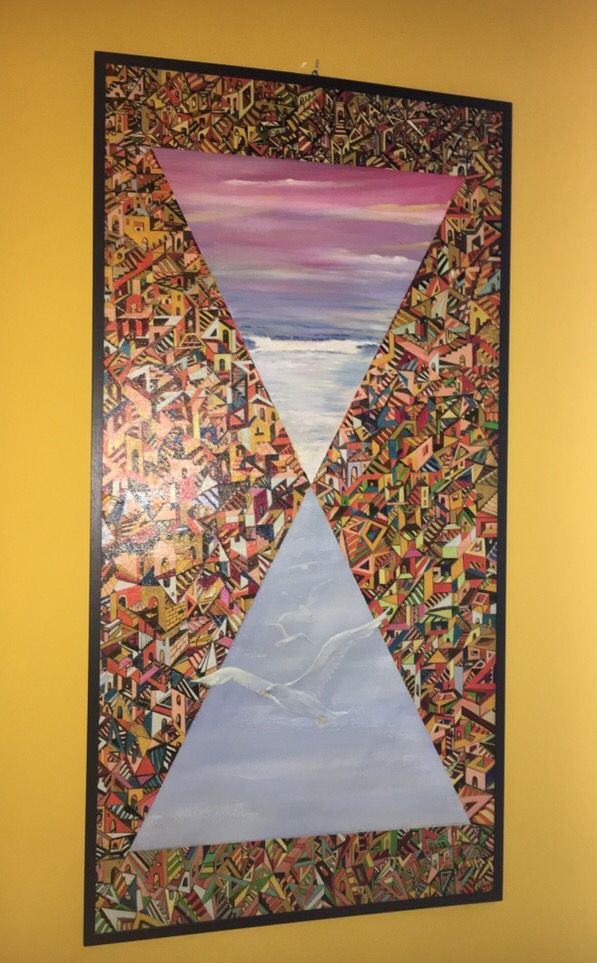Olio su legno, titolo migranti in cerca di libertà, la forma di clessidra indica il tempo, il mare l'unica strada, il labirinto indica la difficoltà, il gabbiano la libertà!!