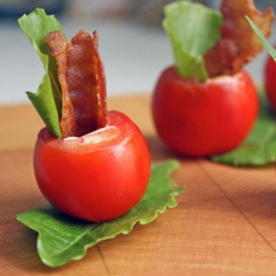 These BLT Cups are the perfect bite sized wedding appetizer.  You get some crispy bacon and smokey chipotle aioli all inside a perfectly juicy grape tomato. Oh ya, and there's even a little piece of arugula just to make the whole thing look extra pretty.  These mini BLT cups are going to fly off the plate!