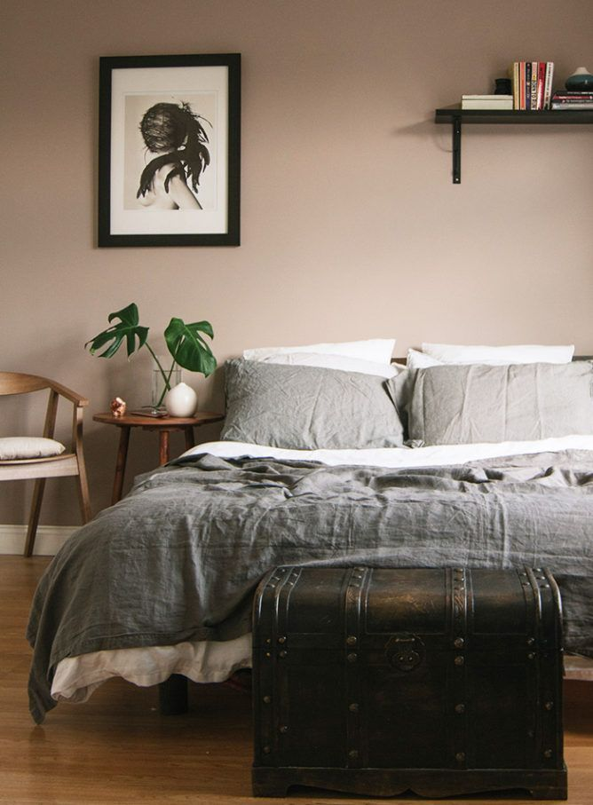 The mauve-meets-tan tone on Lucie and Philip's bedroom walls gives the room a depth that white paint couldn't. Try Benjamin Moore 1241 Morristown Cream