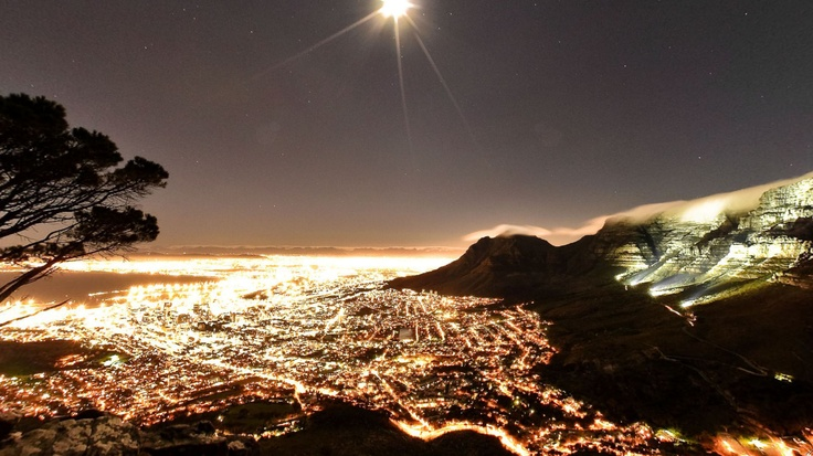 Lions Head, Cape Town, South Africa. Every full moon, families, friends, and couples hike to the top of Lions Head to picnic and drink wine as they watch the city fade into night. On these special nights, no one is a stranger as everyone  joins together in their shared appreciation for the beauties that surround us daily.