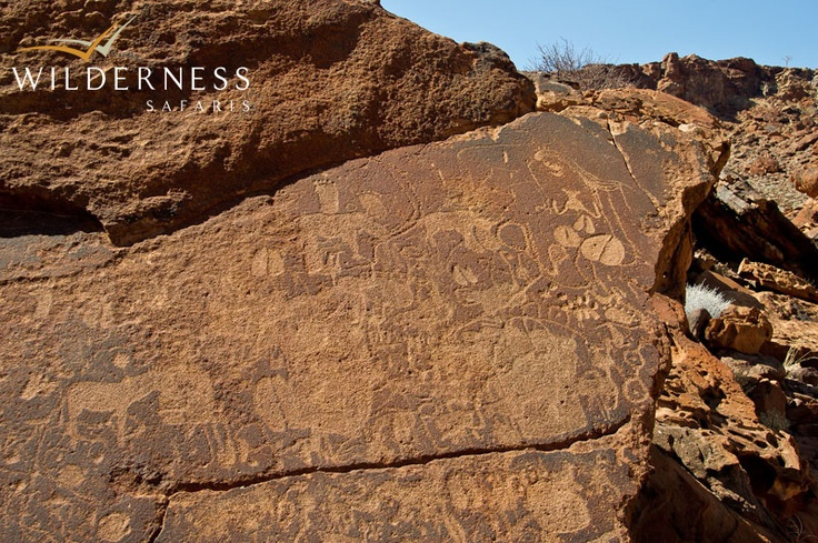 Doro Nawas Camp - Twyfelfontein has the largest collection of petroglyphs (prehistoric rock art) in Africa. Visit the Damara Living Museum and learn about the fascinating traditional culture of the Damara people. This combination of Africa past and present makes for a truly unique and unforgettable experience. #Safari #Africa #Namibia #WildernessSafaris