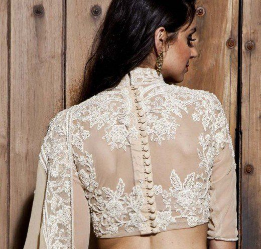 buttons running down the back of off-white embroidered blouse with beige saree