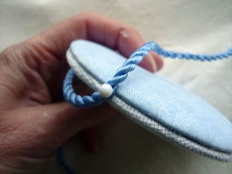 How to sew the edges and wrap them around padded cardboard to create a 2-sided puffy ornament (wrapped with rope).