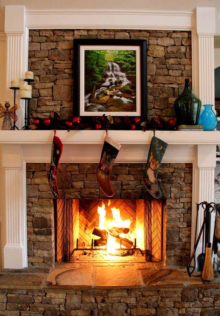 Love the wood mixed with the fireplace adn the slate hearth.  Whats with the picture?  don't like that on this fireplace, especially at Christmas.
