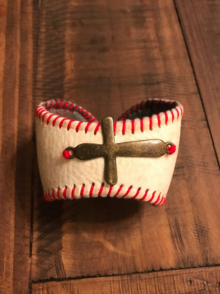 A personal favorite from my Etsy shop https://www.etsy.com/listing/575794330/baseball-bracelet-cuff-with-cross