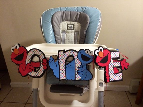 This is a listing for Sesame Street high chair birthday banner ONE with the die cut characters of elmo and Cookie Monster holding each multi colored