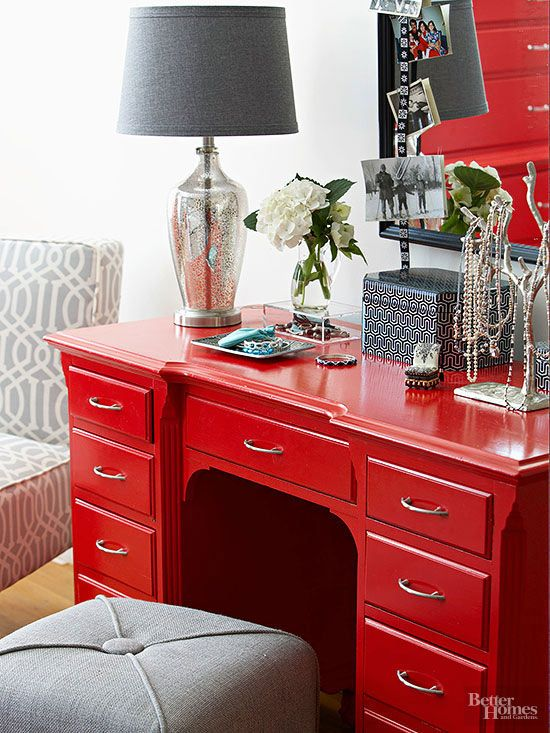 Glossy red paint and new hardware redeemed the piece. Go the next slide to learn how to paint furniture like a pro. /