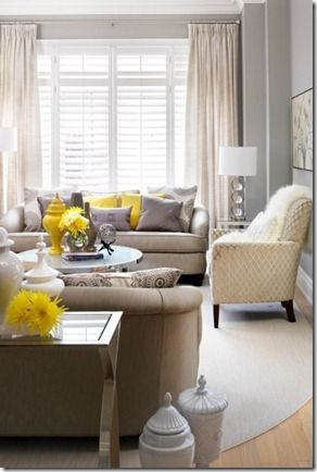 Super into this! I really like the muted tones of the furniture contrasted with the brights of the accents.