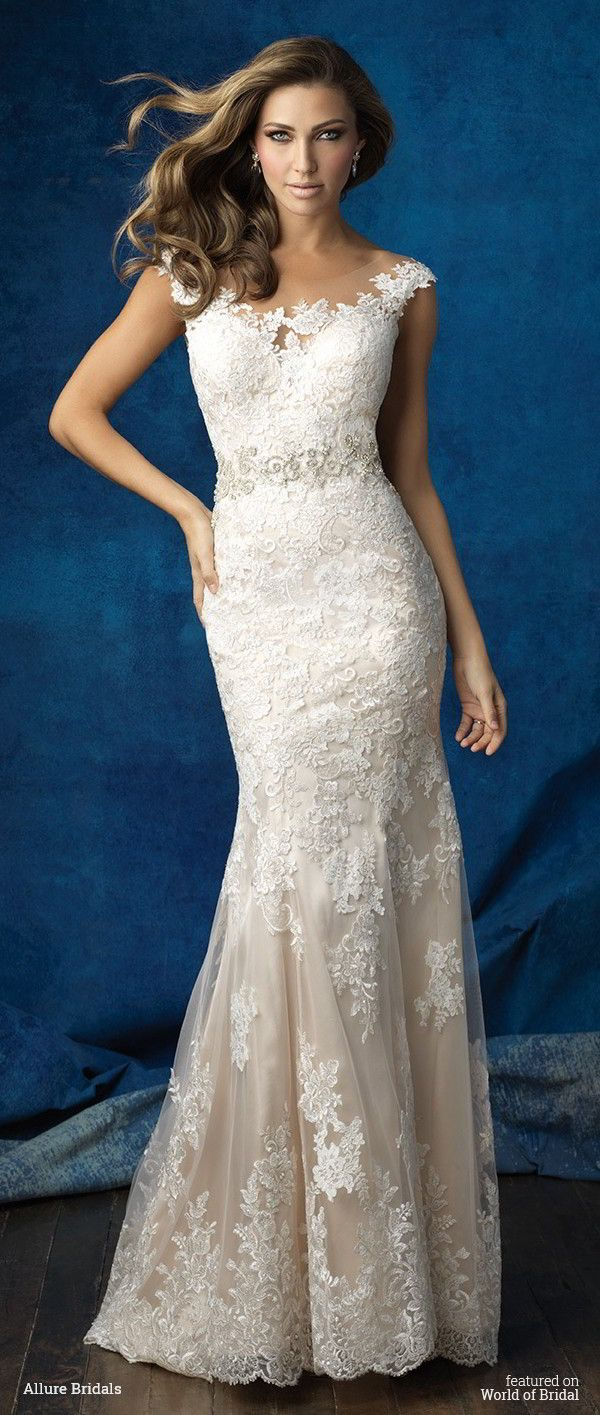 On this lace sheath, a bateau illusion neckline gives way to a dramatic back.