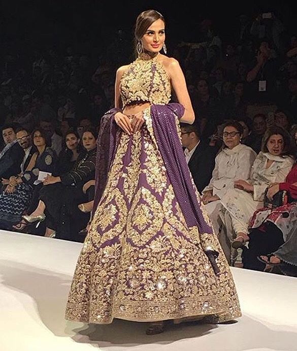 I am not a huge fan of the colour, I don't think purple does this lehnga justice, however love the work on this, but he design is exquisite