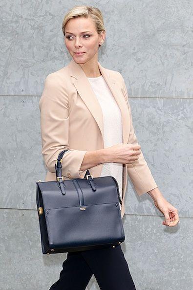 2.28.13  Princess Charlene of Monaco w/ Armani S13 flats ($595) and handbag ($1115) at Giorgio Armani F13 RTW - Milan FW