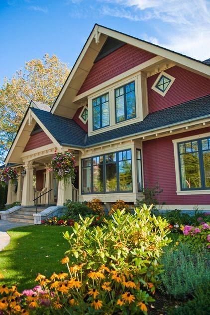 Beautiful, traditional craftsman home exterior painted perfectly for fall in rich ruby-red hues with a light gold trim. Paint to try: Antique Ruby from Behr | Feature Projects