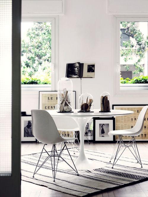Bright, light and airy dining room with Saarinen Tulip Table & Eames DSR Chair
