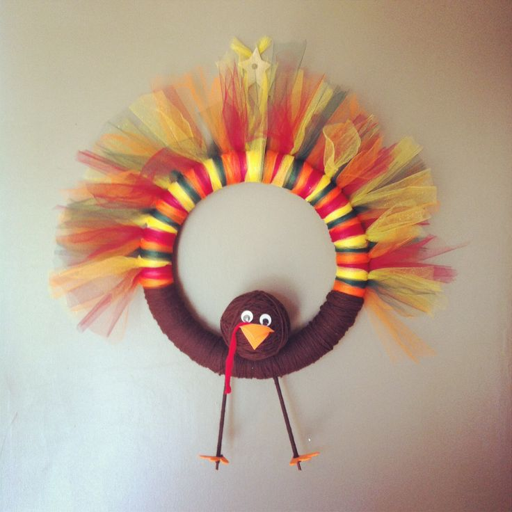 Tom Turkey Tulle and Yarn Wreath. No sew, no glue. Sticky back eyes, foam feet and beak (fixed in place with sewing pins) and thin dowels for legs and neck.