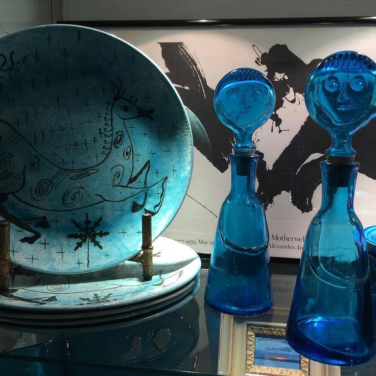In the showcase turquoise blue rules#midcenturydesign #midcenturymodern #midcentury #decanters #ceramics #siamfordct #interiordesign #designer