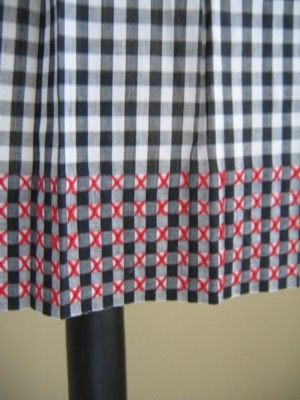 Cross stitch on gingham........maybe make a little pillow?