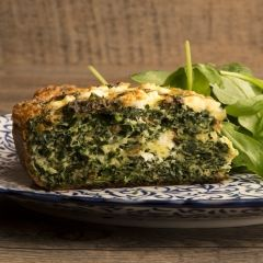 "Kale & Feta Cake - In the office, we call this tasty frittata ""Kale Cake"" mainly because it's layered in the middle with feta. It's really more of a flourless tourte, but whatever you call it, this is a delicious, nutritious way to turn the super-food kale into a crowd pleasing main course. It's easy to make, even when you're feeling tired, and is a great item to dispel the food blahs for people on a neutropenic diet. All in all, it takes the cake!"