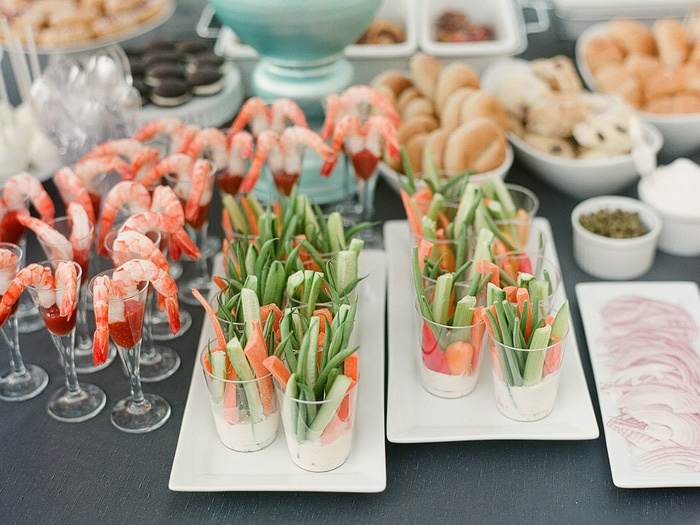 Such an amazing way to lay out a party buffet table, and so kind to the guests to put everything in glasses.