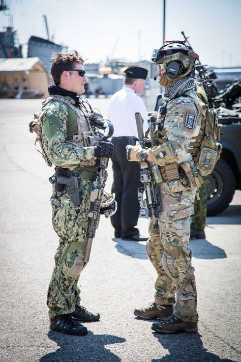 A Navy Seal and a Polish GROM talking at a joint training exercise [1365x2048]