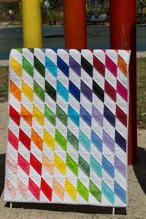 Rainbow Diamonds baby quilt - half-square triangles