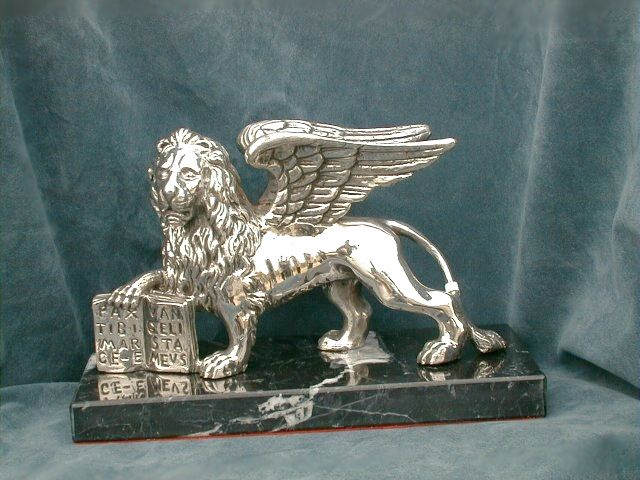 Great Lion of St. Mark 925 silver even in the golden version or around 18 or 14 kt gold Realization finished chiseled. Made with silver bases, marble, wood. Dogale Jewellery Venice Italia www.veneziagioielli.com