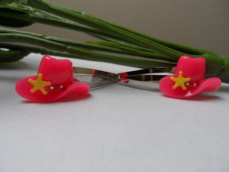 A personal favorite from my Etsy shop https://www.etsy.com/listing/219340689/set-of-girls-2-pink-cowboy-hat-snap