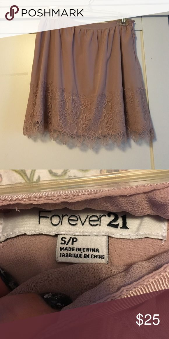 Forever 21 blush lace skirt Perfect for the fall with maroon tights... A white cami... Ivory cardigan... Riding boots... That's how I always wore this... Including my last years Thanksgiving outfit 😉 but would look great with a tank top and some sandals as well. Forever 21 Skirts Mini