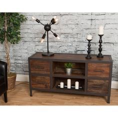 Come in and turn on the TV. Take a seat. Relax. Admire the black ironwork flanking the rustic wood in your new media console. See the knots and woodgrain infused into the wood. Pull out a movie from o