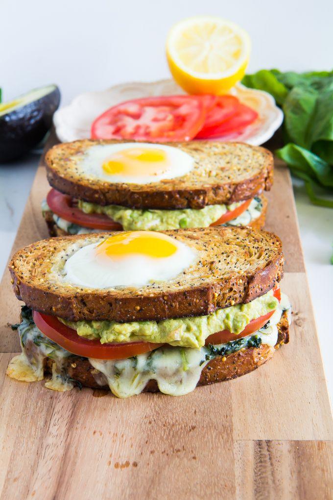 Three Greens Breakfast Sandwich with Fancy Guacamole // goat cheese sriracha guacamole, mozzarella, greens, tomato, egg