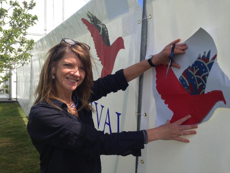 The fabulous @ainevenables - festival cover artist and Moot Bird maker, decorating the garden wall x