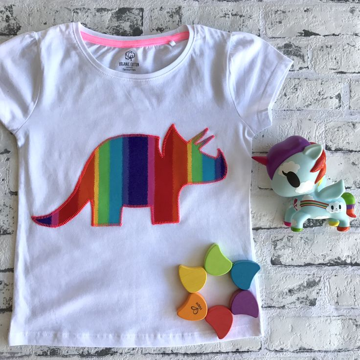 Bright and colourful, Rainbowsaurus goes with everything !  An applique rainbow triceratops on our new premium unisex tee.  Available in black or white.  Onesies are all short sleeved - if you would prefer singlet or long sleeved please leave a note at checkout.  Click the pin to buy your rainbow dinosaur shirt now!