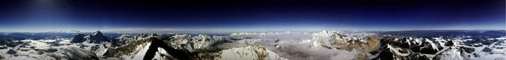 Top of the world: 360-degree view from the peak of Mount Everest.   This is not my photo — it was taken by Roderick Mackenzie on May 24, 1989.