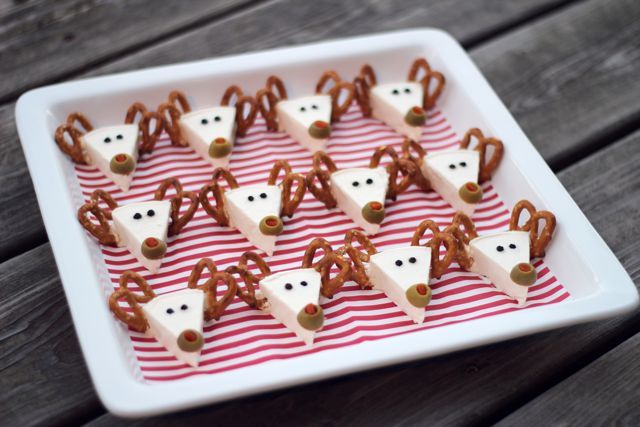 Reindeer - Made with Laughing Cow spreadable cheese triangles with pretzel twist antlers, peppercorn eyes and olive noses.