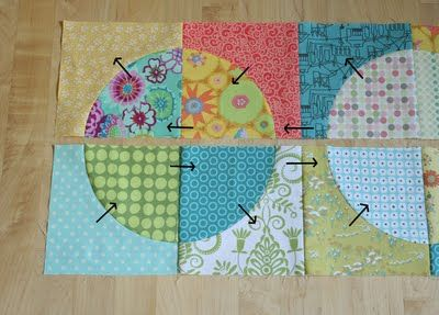 crazy mom quilts: running in circles tutorial - uses a special template and requires curved seams, but I could do this.