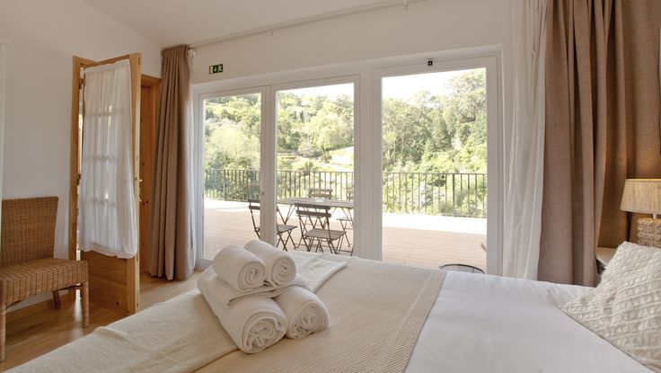 The bedroom of the superior suite has an excellent view through the wall-to-wall windows  #bedandbreakfast #Sintra #Portugal #casadovalle #roomwithaview