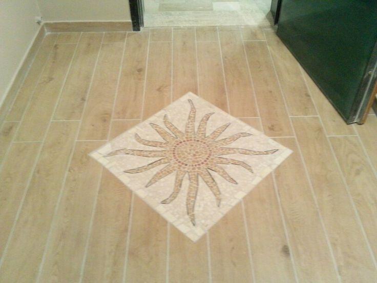 Ingresso piastrellato con mosaico