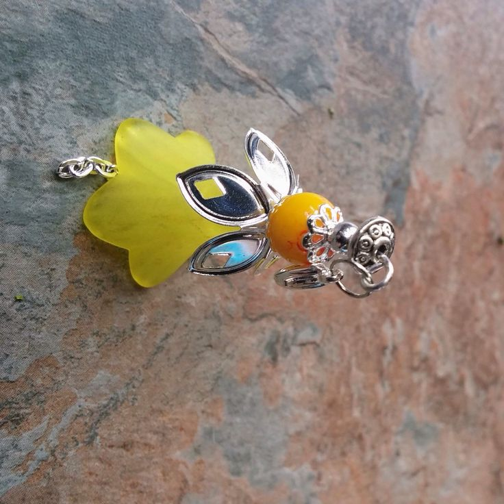 Yellow frosted flower with silver chains a yellow marble glass bead handcrafted with silver Lobster clasp phone/key/bag/zipper charm/pendant a lovely gift idea. Thank you for your time.
