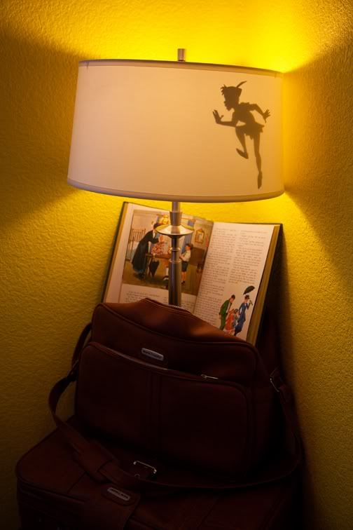 "I wonder if there is a way to use this idea to project a shadow on the wall?   ""...a cut out of Peter Pan's shadow and put it in the lamp so when you turn it on you get this..."" from Alisha Hurt Photography."