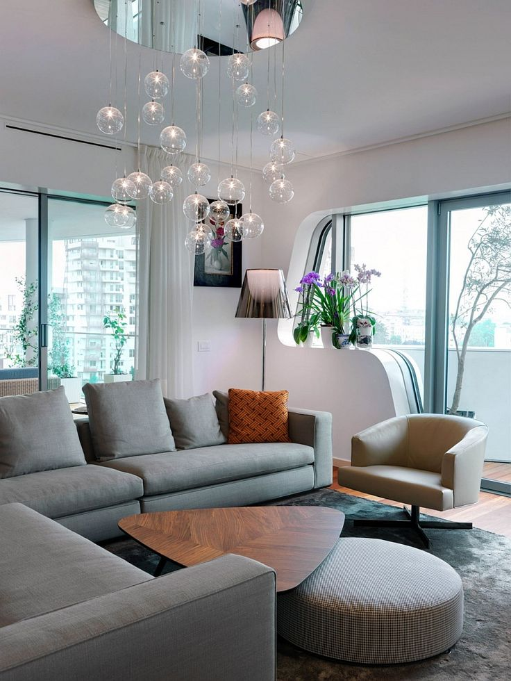 Apartments:Stunning Cascading Chadelier In Modern Living Room Of Modern Interior Design Of Luxury Apartment In Milan With Gray Sofas Also Wooden Table Also Round Sofa Also Gray Rugs Also Floor Lamp Modern Interior Design of Luxury Apartment in Milan To Inspire You