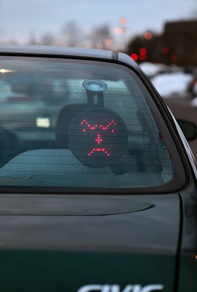 This goes on your back windshield  you have a control upfront that lets you send messages to people behind you. there are 16 different messages. Hahahahahaha I need this!!