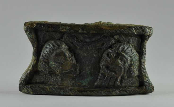 Roman theater masks on Roman bronze fitting, 1st century A.C.  6.2 cm high. Private collection