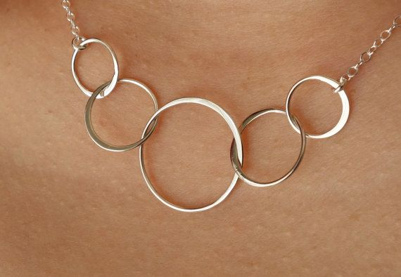 Hey, I found this really awesome Etsy listing at http://www.etsy.com/listing/158147289/five-silver-linked-circles-necklace-in
