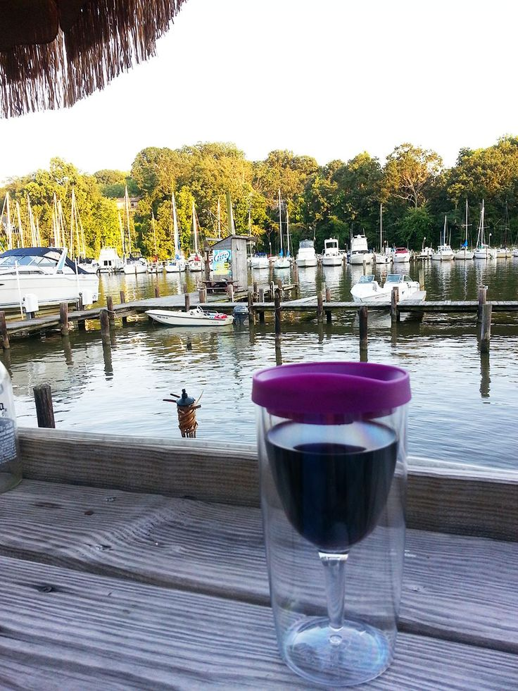 Deep Creek Restaurant and Marina in Arnold, Maryland.There's an outdoor Tiki bar in the summer and you can watch the boats drift by or dock for dinner. No one has better crab than we have in the Chesapeake Bay and Deep Creek Restaurant makes the best crab cake of anywhere. My wine cup filled at the Tiki Bar and a crab cake and the night is set! (BTW, the waitresses are super jealous of my wine cup so if I win I'm giving them all one!) :)