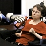 This woman is telekinetic. Her brain controls the robot arm that gives her a drink. Imagine what this could do....