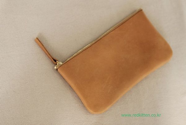 Korea womens apparel shopping mall [REDKITTEN] Vegetable leather pouch / Size : FREE / Price : 41.62 USD #korea #fashion #style #fashionshop #woman-fashion #casual #ootd #basic #daily #leather #皮 #革 #pouch