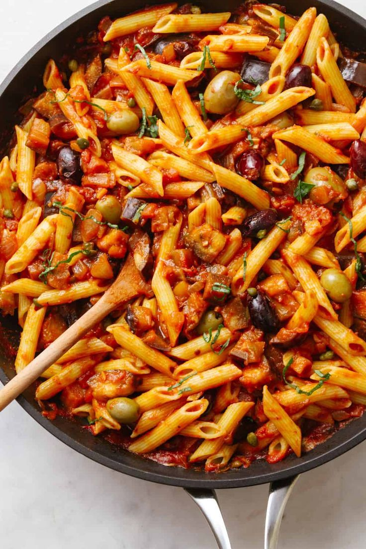Eggplant Puttanesca Recipe With Olives Capers And Red Pepper Flakes Is Hearty Delicious And So Easy To Eggplant Recipes Pasta Eggplant Pasta Vegan Pasta Dish