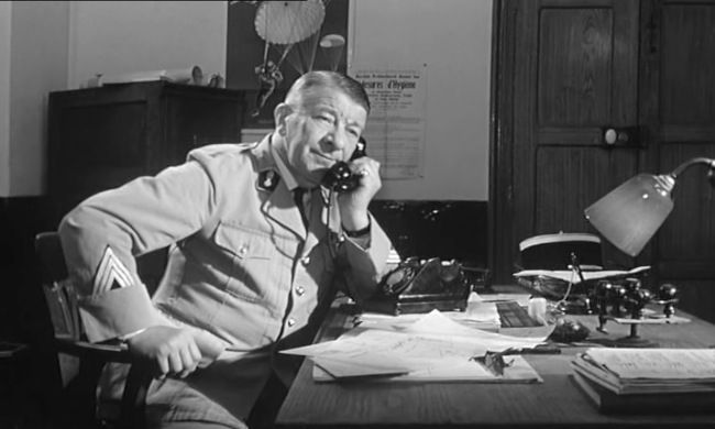 french actor robert dalban  on the phone