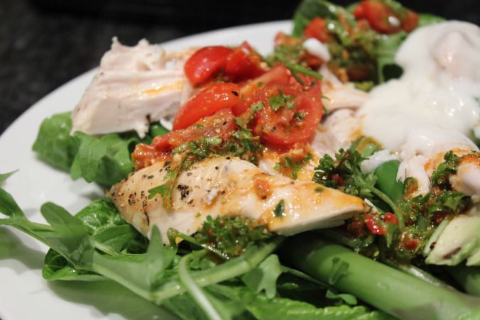 Lemon-thyme roast chicken salad with red pepper pesto and tomato dressing and garlic yoghurt